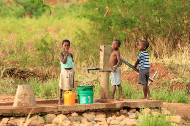 Children fetching water from their local well